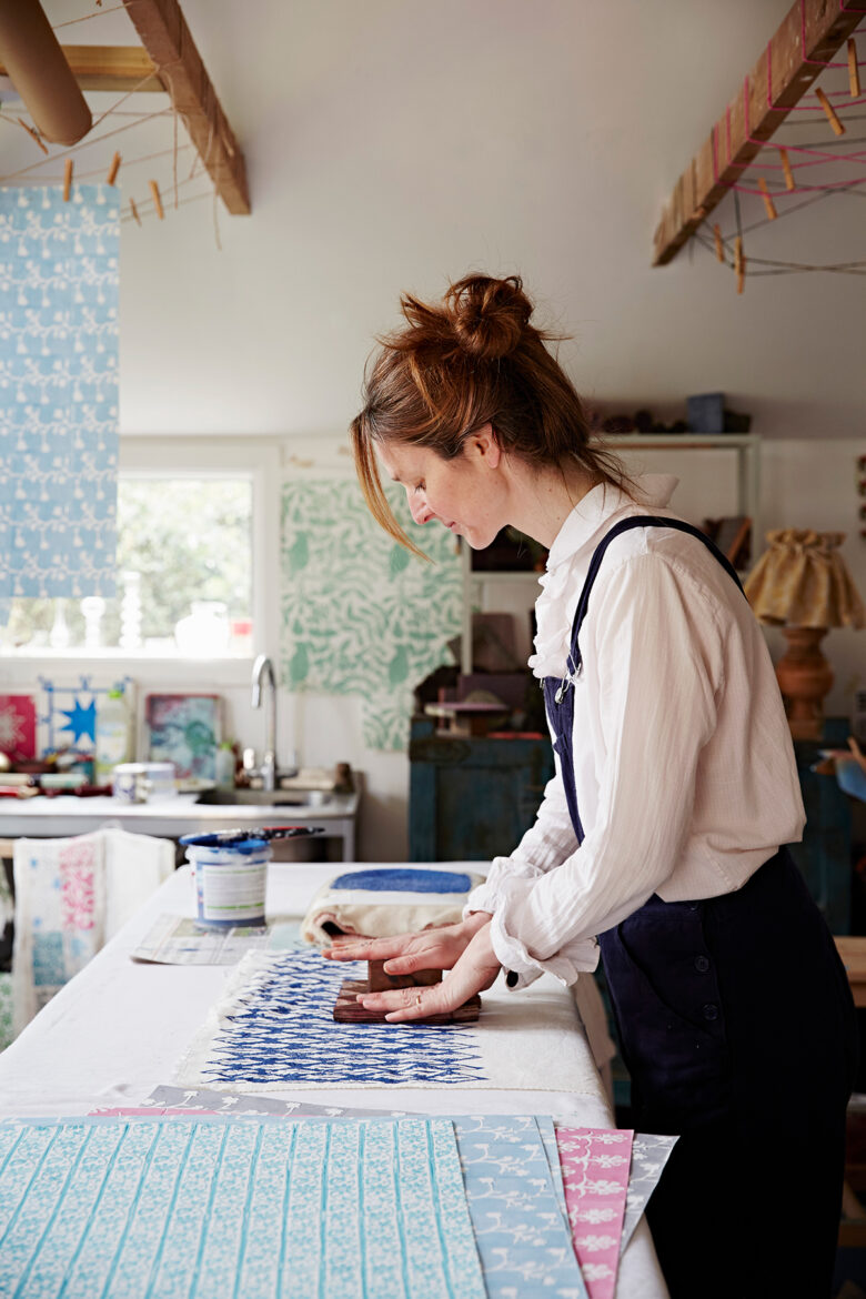 Designer and block print-maker Molly Mahon uses wooden blocks to print fabric at her studio at her home in Ashdown Forest, East Sussex