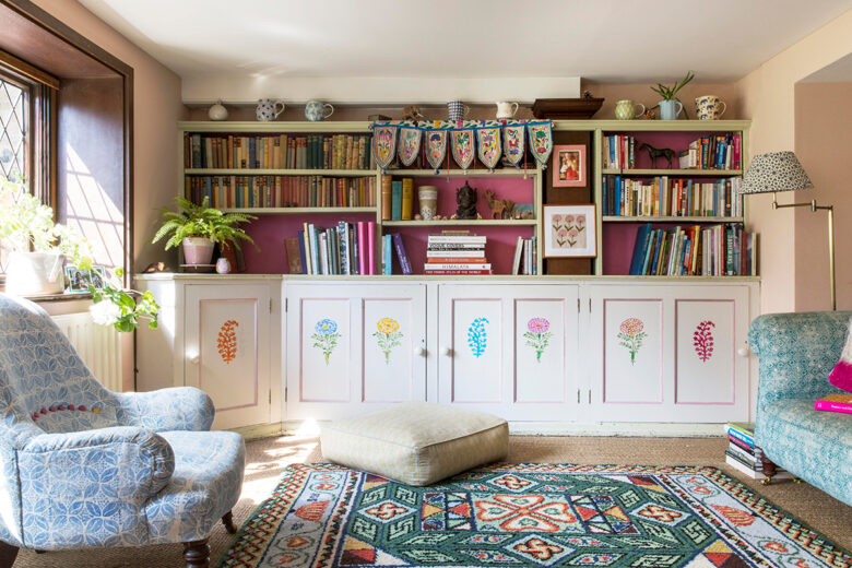 Open shelving, stencilled cupboards and hand block printed fabric in the living room of designer Molly Mahon in Ashdown Forest, East Sussex
